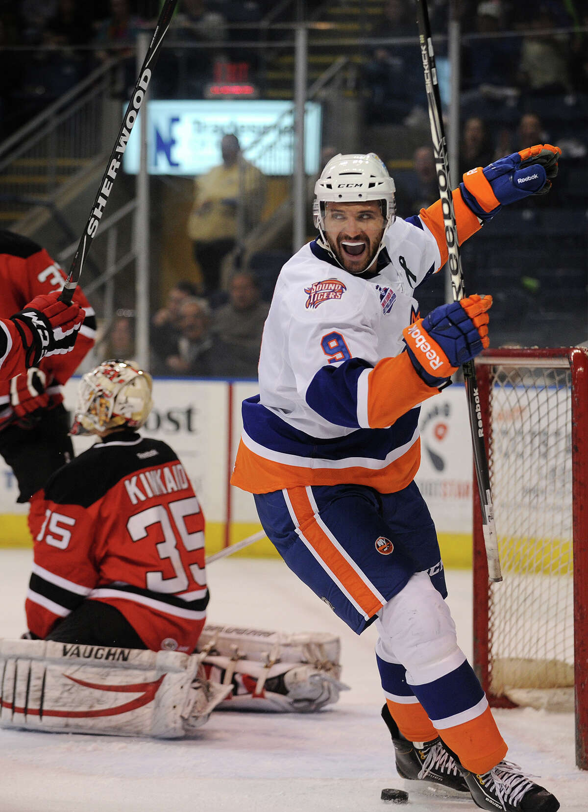 Sound Tiger Sean Wiles, left, celebrates teammate Jordan Hill's second goal of the game during the second period of their matchup with the Albany Devils at the Webster Bank Arena in Bridgeport, Conn. on Sunday, March 24, 2013.
