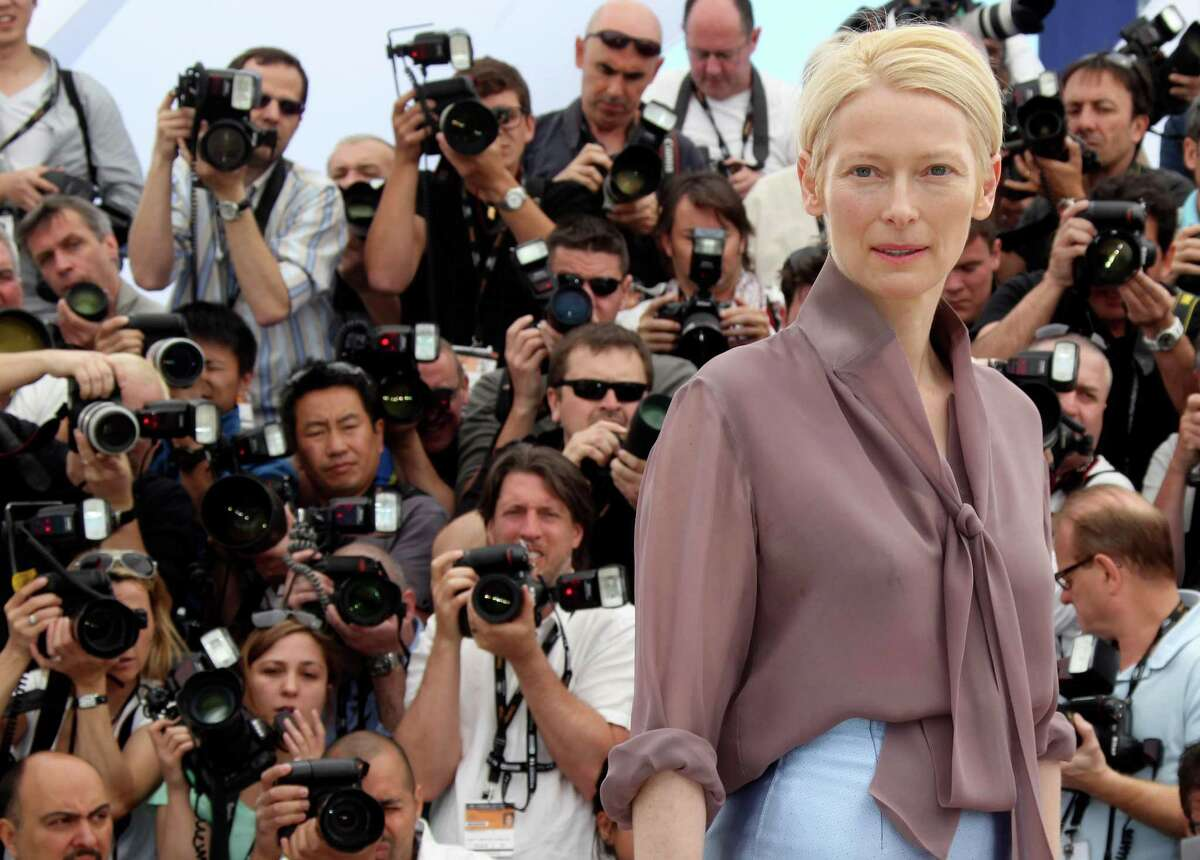 """FILE - In this May 16, 2012, file photo, actress Tilda Swinton poses during a photo call for Moonrise Kingdom at the 65th international film festival, in Cannes, southern France. Actress Tilda Swinton is performing the art of sleeping at New York City?'s Museum of Modern Art. A museum spokeswoman says the ?""""Moonrise Kingdom?"""" star presented her one-person piece called ?""""The Maybe?"""" on Saturday, March 23, 2013. (AP Photo/Joel Ryan, File)"""