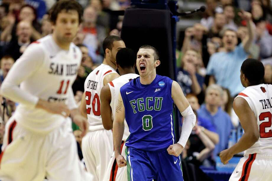 PHILADELPHIA, PA - MARCH 24:  Brett Comer #0 of the Florida Gulf Coast Eagles reacts in the second half while taking on the San Diego State Aztecs during the third round of the 2013 NCAA Men's Basketball Tournament at Wells Fargo Center on March 24, 2013 in Philadelphia, Pennsylvania. Photo: Rob Carr, Getty Images / 2013 Getty Images