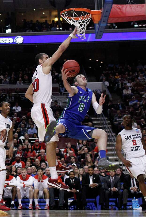 PHILADELPHIA, PA - MARCH 24:  Brett Comer #0 of the Florida Gulf Coast Eagles goes up for a shot against JJ O'Brien #20 of the San Diego State Aztecs in the first half during the third round of the 2013 NCAA Men's Basketball Tournament at Wells Fargo Center on March 24, 2013 in Philadelphia, Pennsylvania. Photo: Rob Carr, Getty Images / 2013 Getty Images