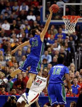 PHILADELPHIA, PA - MARCH 24:  Chase Fieler #20 of the Florida Gulf Coast Eagles dunks over Deshawn Stephens #23 of the San Diego State Aztecs and is fouled in the first half during the third round of the 2013 NCAA Men's Basketball Tournament at Wells Fargo Center on March 24, 2013 in Philadelphia, Pennsylvania. Photo: Elsa, Getty Images / 2013 Getty Images