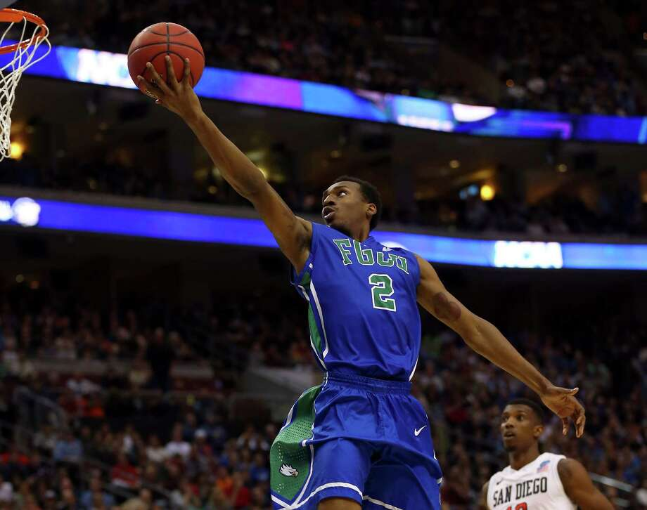 PHILADELPHIA, PA - MARCH 24:  Bernard Thompson #2 of the Florida Gulf Coast Eagles lays up the ball in the second half against the San Diego State Aztecs during the third round of the 2013 NCAA Men's Basketball Tournament at Wells Fargo Center on March 24, 2013 in Philadelphia, Pennsylvania. Photo: Elsa, Getty Images / 2013 Getty Images
