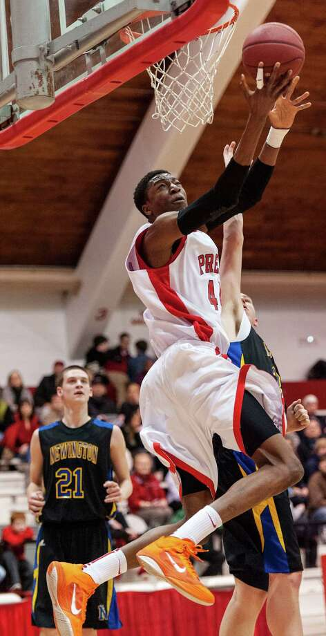 Paschal Chukwu, Fairfield Prep, goes up for a layup during a second round 2013 CIAC class LL boys basketball tournament game against Newington high school held at Alumni Hall, Fairfield University, Fairfield CT on Wednesday March 6th 2013. Photo: Mark Conrad / Connecticut Post Freelance