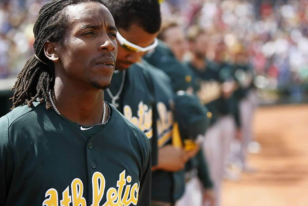 Oakland A's second baseman Jemile Weeks listens to the National Anthem prior to a spring training baseball game between the Oakland Athletics and the Cincinnati Reds on March 21, 2013 in Goodyear, Arizona.