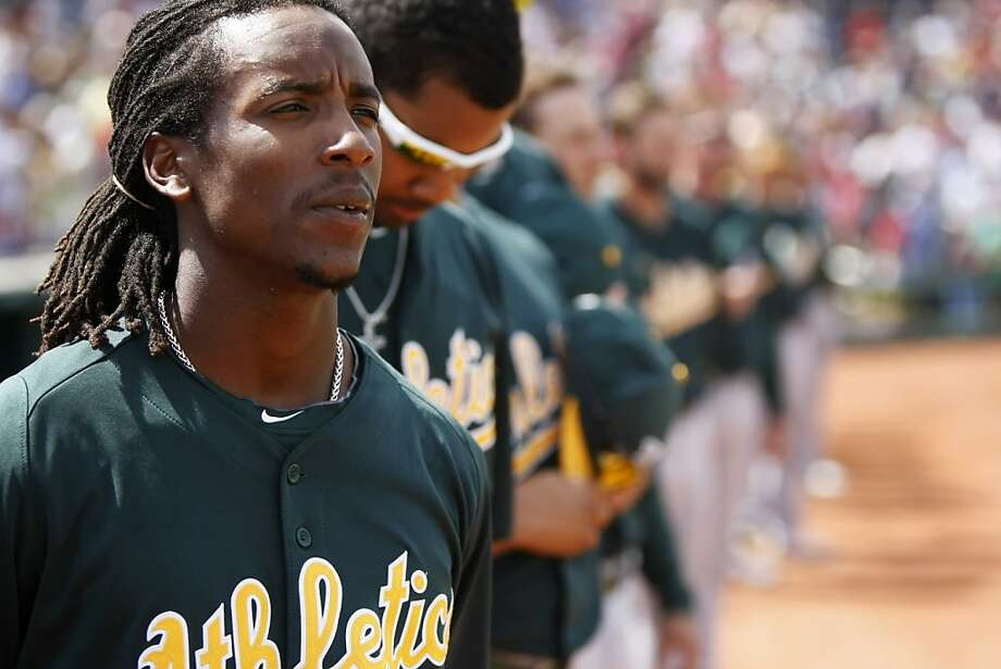 Oakland A's second baseman Jemile Weeks listens to the National Anthem prior to a spring training baseball game between the Oakland Athletics and the Cincinnati Reds on March 21, 2013 in Goodyear, Arizona. Photo: Pete Kiehart, The Chronicle