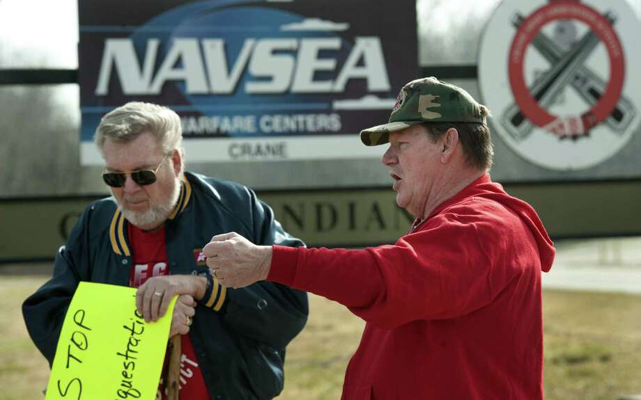 Jimmy Colvin (right), president of American Federation of Government Employees Local 1415 at NSA Crane, speaks at a protest in Crane, Ind., just outside the military facility's main gate, along with Roy Pannell, an AFGE district official. The employees are protesting a three-year pay freeze and pending 22-day work furlough resulting from automatic federal budget cuts. Photo: David Snodgress / Bloomington Herald-Times