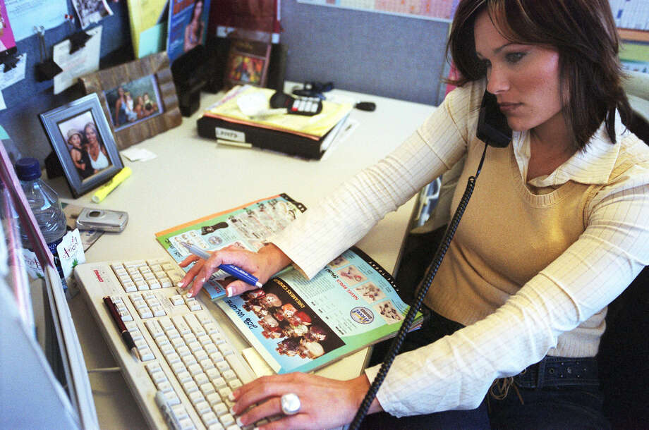 Tammy Gates talks to clients through Salon Support, a firm that sells tanning lotion. People are urged to learn their rights when dealing with telephone solicitors. Photo: Fort Worth Star-Telegram File Photo