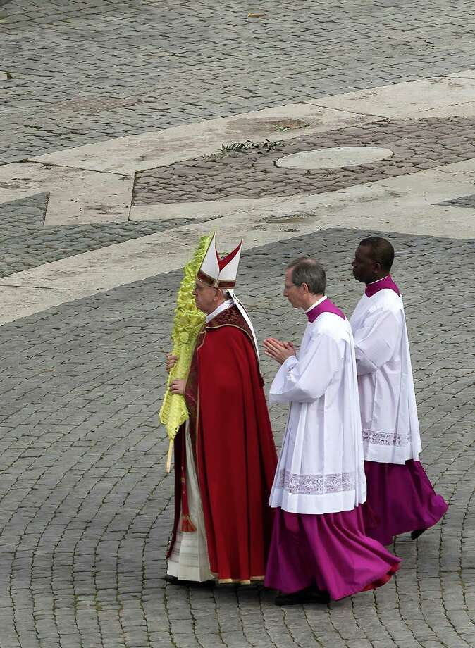 Pope Francis participates in the procession before the Palm Sunday Mass in St. Peter's Square at the Vatican, Sunday, March 24, 2013. Pope Francis celebrated his first Palm Sunday Mass in St. Peter's Square, encouraging people to be humble and young at heart, as tens of thousands joyfully waved olive branches and palm fronds. (AP Photo/Domenico Stinellis) Photo: Domenico Stinellis, Associated Press / AP