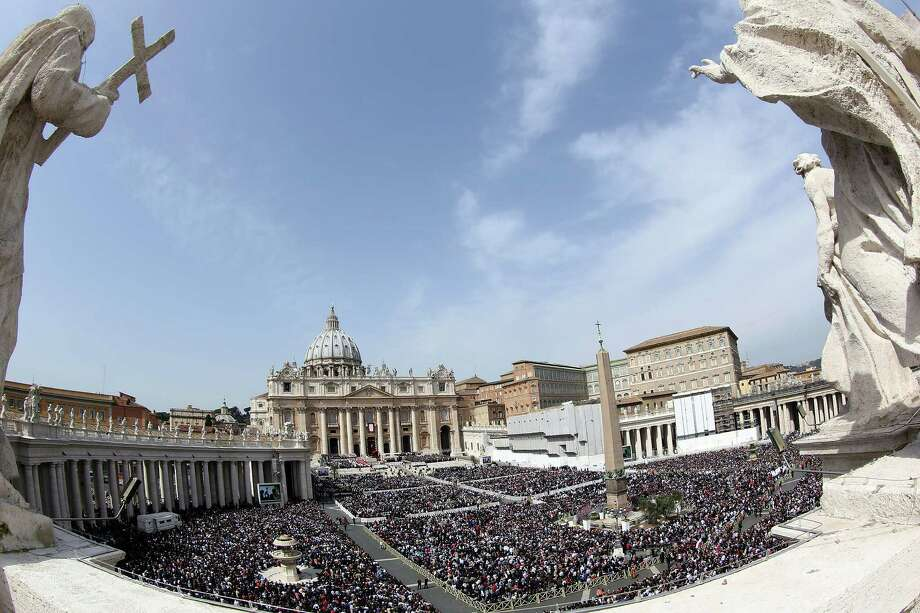 A view of St. Peter's Square during Palm Sunday Mass held by Pope Francis on March 24, 2013 in Vatican City, Vatican. Pope Francis lead his first mass of Holy Week as pontiff by celebrating Palm Sunday in front of thousands of faithful and clergy. The pope's first holy week will also incorporate him washing the feet of prisoners in a youth detention centre in Rome next Thursday, 28th March. Photo: Franco Origlia, Getty Images / 2013 Getty Images