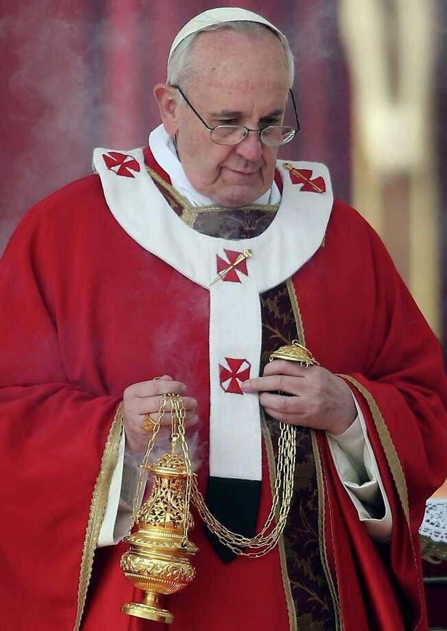 Pope Francis attends Palm Sunday Mass in St. Peter's Square on March 24, 2013 in Vatican City, Vatican. Pope Francis lead his first mass of Holy Week as pontiff by celebrating Palm Sunday in front of thousands of faithful and clergy. The pope's first holy week will also incorporate him washing the feet of prisoners in a youth detention centre in Rome next Thursday March 28. Photo: Christopher Furlong, Getty Images / 2013 Getty Images