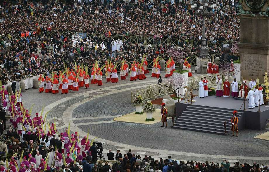 Pope Francis delivers Palm Sunday Mass in St. Peter's Square on March 24, 2013 in Vatican City, Vatican. Pope Francis led his first mass of Holy Week as pontiff by celebrating Palm Sunday in front of thousands of faithful and clergy. The pope's first holy week will also incorporate him washing the feet of prisoners in a youth detention centre in Rome next Thursday, 28th March. Photo: Jeff J Mitchell, Getty Images / 2013 Getty Images