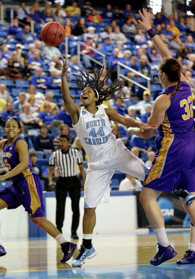North Carolina guard Tierra Ruffin-Pratt (44) shoots between Albany's Ebone Henry, left, and Megan Craig during the first half of a first-round game in the women's NCAA college basketball tournament in Newark, Del., Sunday, March 24, 2013. Ruffin-Pratt contributed a game-high 30 points to North Carolina's 59-54 win. (AP Photo/Patrick Semansky) Photo: Patrick Semansky / AP