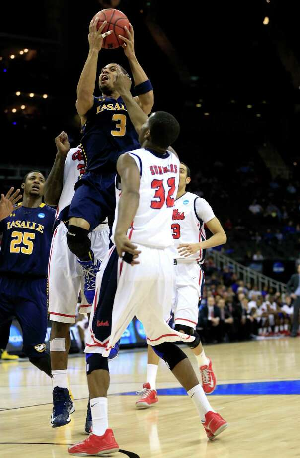 KANSAS CITY, MO - MARCH 24:  Tyreek Duren #3 of the La Salle Explorers drives for a shot attempt in the second half against Jarvis Summers #32 of the Mississippi Rebels during the third round of the 2013 NCAA Men's Basketball Tournament at Sprint Center on March 24, 2013 in Kansas City, Missouri. Photo: Jamie Squire, Getty Images / 2013 Getty Images