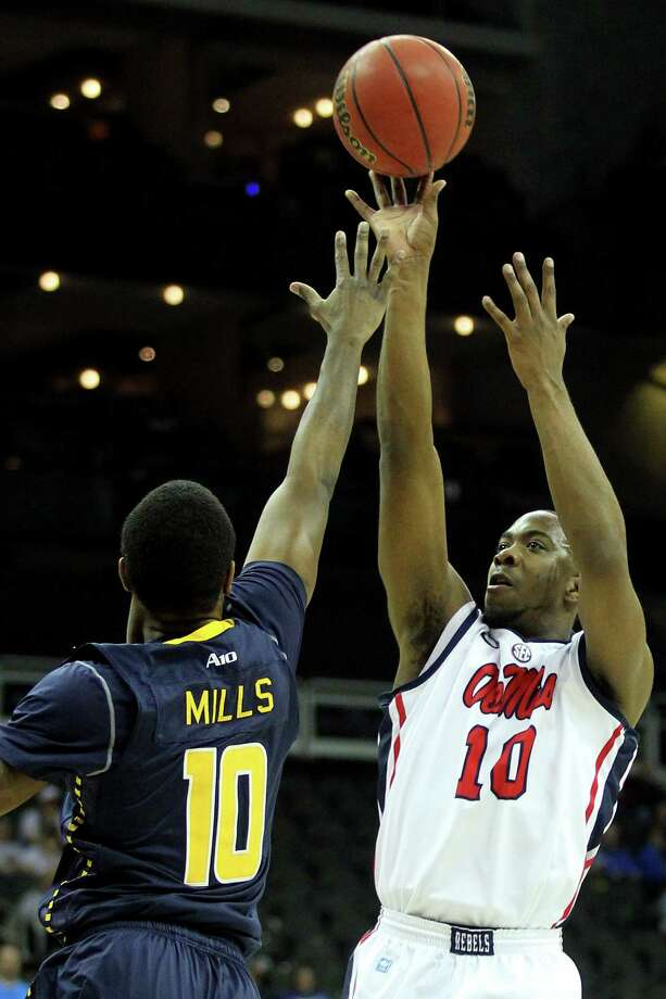 KANSAS CITY, MO - MARCH 24:  Ladarius White #10 of the Mississippi Rebels attempts a shot against the La Salle Explorers during the third round of the 2013 NCAA Men's Basketball Tournament at Sprint Center on March 24, 2013 in Kansas City, Missouri. Photo: Ed Zurga, Getty Images / 2013 Getty Images