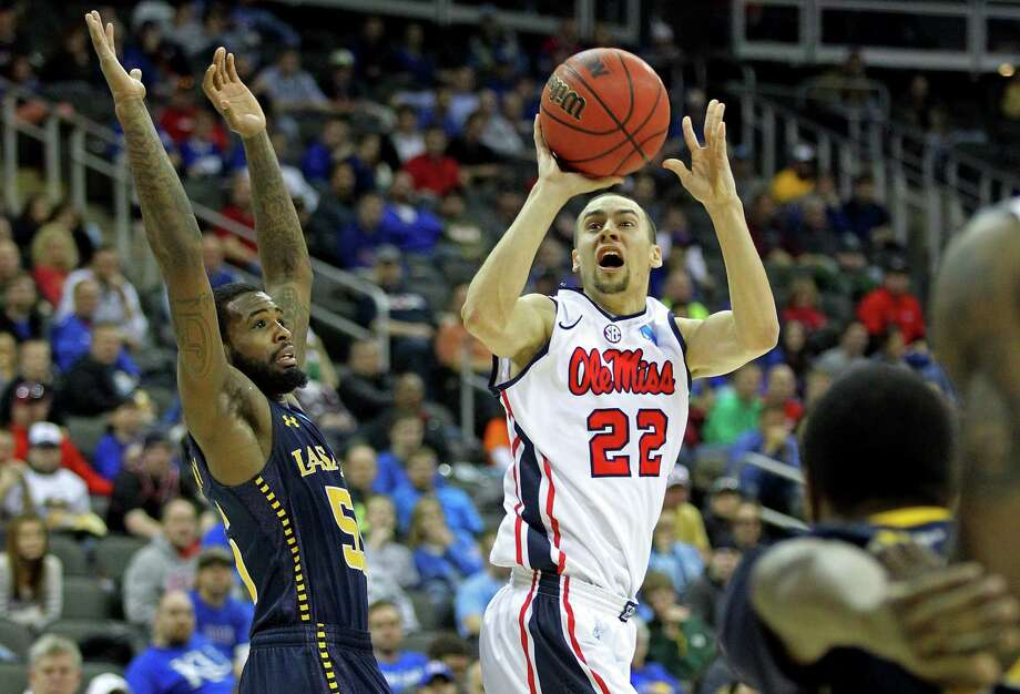 KANSAS CITY, MO - MARCH 24:  Marshall Henderson #22 of the Mississippi Rebels attempts a shot in the second half against Ramon Galloway #55 of the La Salle Explorers during the third round of the 2013 NCAA Men's Basketball Tournament at Sprint Center on March 24, 2013 in Kansas City, Missouri. Photo: Ed Zurga, Getty Images / 2013 Getty Images