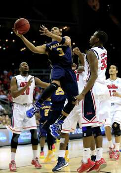 La Salle 76, Ole Miss 74KANSAS CITY, MO - MARCH 24:  Tyreek Duren #3 of the La Salle Explorers drives for a shot attempt in the second half against Jarvis Summers #32 of the Mississippi Rebels during the third round of the 2013 NCAA Men's Basketball Tournament at Sprint Center on March 24, 2013 in Kansas City, Missouri. Photo: Jamie Squire, Getty Images / 2013 Getty Images