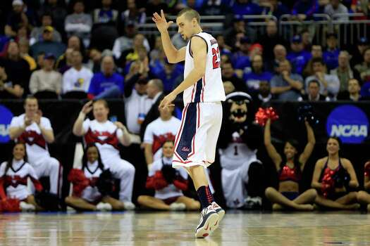 KANSAS CITY, MO - MARCH 24:  Marshall Henderson #22 of the Mississippi Rebels reacts after he made a 3-point shot in the first half against the La Salle Explorers during the third round of the 2013 NCAA Men's Basketball Tournament at Sprint Center on March 24, 2013 in Kansas City, Missouri. Photo: Jamie Squire, Getty Images / 2013 Getty Images