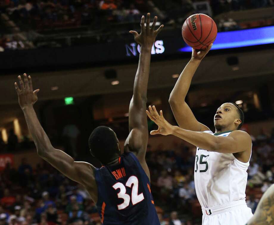 AUSTIN, TX - MARCH 24:  Kenny Kadji #35 of the Miami Hurricanes shoots over Nnanna Egwu #32 of the Illinois Fighting Illini in the second half during the third round of the 2013 NCAA Men's Basketball Tournament at The Frank Erwin Center on March 24, 2013 in Austin, Texas. Photo: Ronald Martinez, Getty Images / 2013 Getty Images