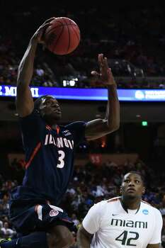 AUSTIN, TX - MARCH 24:  Brandon Paul #3 of the Illinois Fighting Illini shoots over Reggie Johnson #42 of the Miami Hurricanes in the second half during the third round of the 2013 NCAA Men's Basketball Tournament at The Frank Erwin Center on March 24, 2013 in Austin, Texas. Photo: Stephen Dunn, Getty Images / 2013 Getty Images