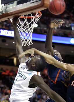 Illinois defenders block the shot of Miami guard Durand Scott (1) during the third round of the men's NCAA basketball tournament at the Frank Erwin Center in Austin, Texas on Sunday, March 24, 2013. (Stephen M. Dowell/Orlando Sentinel/MCT) Photo: Stephen M. Dowell, McClatchy-Tribune News Service / Orlando Sentinel