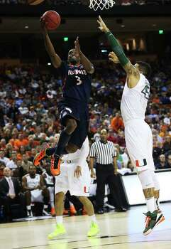 AUSTIN, TX - MARCH 24:  Brandon Paul #3 of the Illinois Fighting Illini goes up against Julian Gamble #45 of the Miami Hurricanes in the first half during the third round of the 2013 NCAA Men's Basketball Tournament at The Frank Erwin Center on March 24, 2013 in Austin, Texas. Photo: Ronald Martinez, Getty Images / 2013 Getty Images