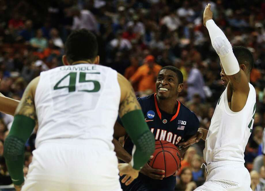 AUSTIN, TX - MARCH 24:  Brandon Paul #3 of the Illinois Fighting Illini looks to shoot against the defense of Shane Larkin #0 and Julian Gamble #45 of the Miami Hurricanes in the first half during the third round of the 2013 NCAA Men's Basketball Tournament at The Frank Erwin Center on March 24, 2013 in Austin, Texas. Photo: Ronald Martinez, Getty Images / 2013 Getty Images