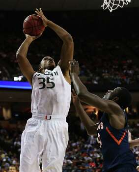 AUSTIN, TX - MARCH 24:  Kenny Kadji #35 of the Miami Hurricanes shoots over Nnanna Egwu #32 of the Illinois Fighting Illini in the first half during the third round of the 2013 NCAA Men's Basketball Tournament at The Frank Erwin Center on March 24, 2013 in Austin, Texas. Photo: Stephen Dunn, Getty Images / 2013 Getty Images