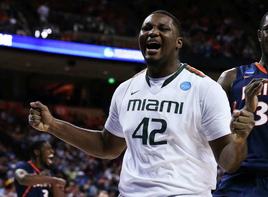 AUSTIN, TX - MARCH 24:  Reggie Johnson #42 of the Miami Hurricanes reacts after loosing the ball in the first half against the Illinois Fighting Illini during the third round of the 2013 NCAA Men's Basketball Tournament at The Frank Erwin Center on March 24, 2013 in Austin, Texas. Photo: Stephen Dunn, Getty Images / 2013 Getty Images