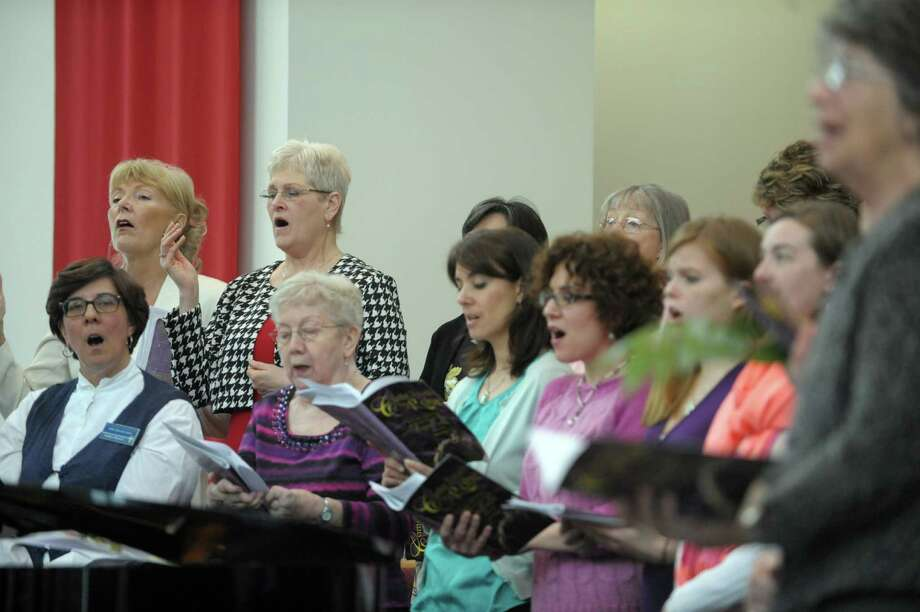 Members of the choir sing during the Palm Sunday cantata service at the Prince of Peace Lutheran Church on Sunday, March 24, 2013 in Clifton Park, NY.  Senior Pastor Jeff Silvernail said that the service allows them to tell the story of the final week of Jesus's life through song, narration and using items of symbolism.  This is the fourth year the church held a cantata for Palm Sunday.  The church will celebrate Easter Sunday with two traditional services at 8am and 11am and a contemporary service at 9:30am.  (Paul Buckowski / Times Union) Photo: Paul Buckowski