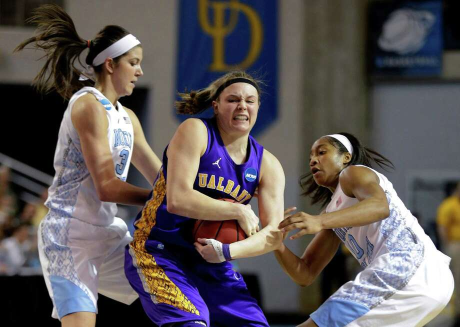 Albany's Sarah Royals, center, tries to protect the ball as she is pressured by North Carolina guards Megan Buckland, left, and Danielle Butts during the first half of a first-round game in the women's NCAA college basketball tournament in Newark, Del., Sunday, March 24, 2013. North Carolina won 59-54. (AP Photo/Patrick Semansky) Photo: Patrick Semansky / AP