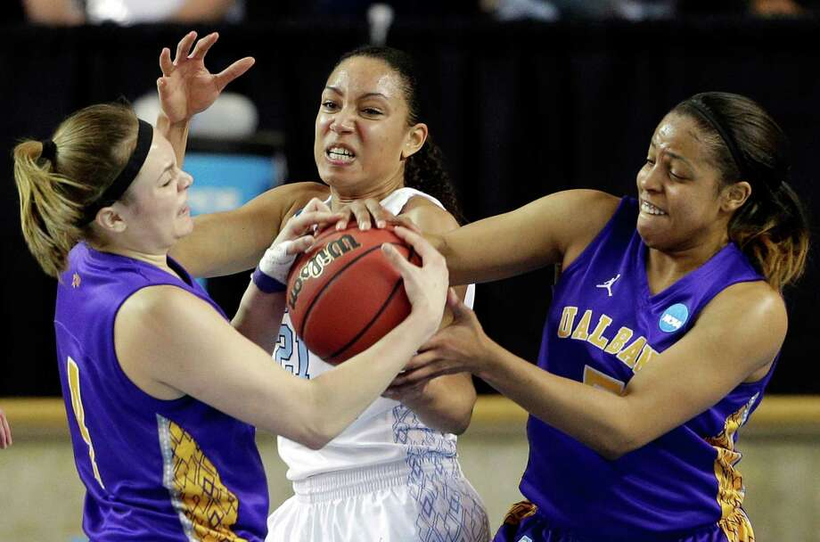 Albany's Sarah Royals, left, and Ebone Henry, right, struggle for possession of the ball with North Carolina's Krista Gross during the first half of a first-round game in the women's NCAA college basketball tournament in Newark, Del., Sunday, March 24, 2013. North Carolina won 59-54. (AP Photo/Patrick Semansky) Photo: Patrick Semansky / AP