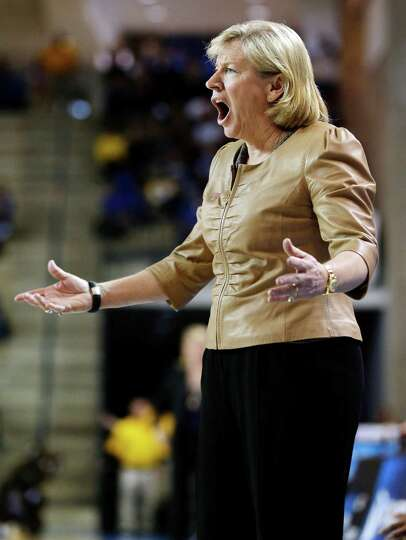 North Carolina head coach Sylvia Hatchell directs her players during the first half of a first-round