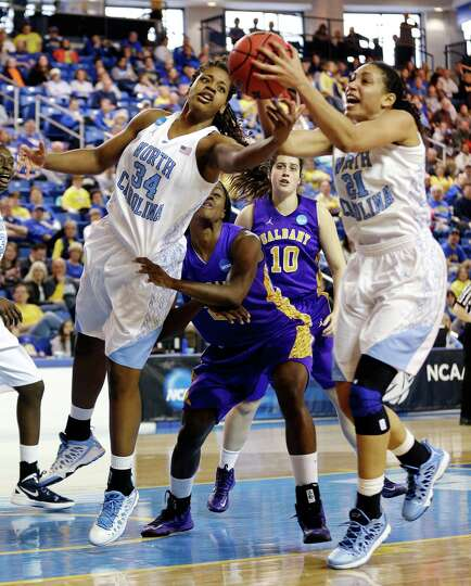 North Carolina's Xylina McDaniel (34) and Krista Gross (21) reach for a rebound in front of Albany's