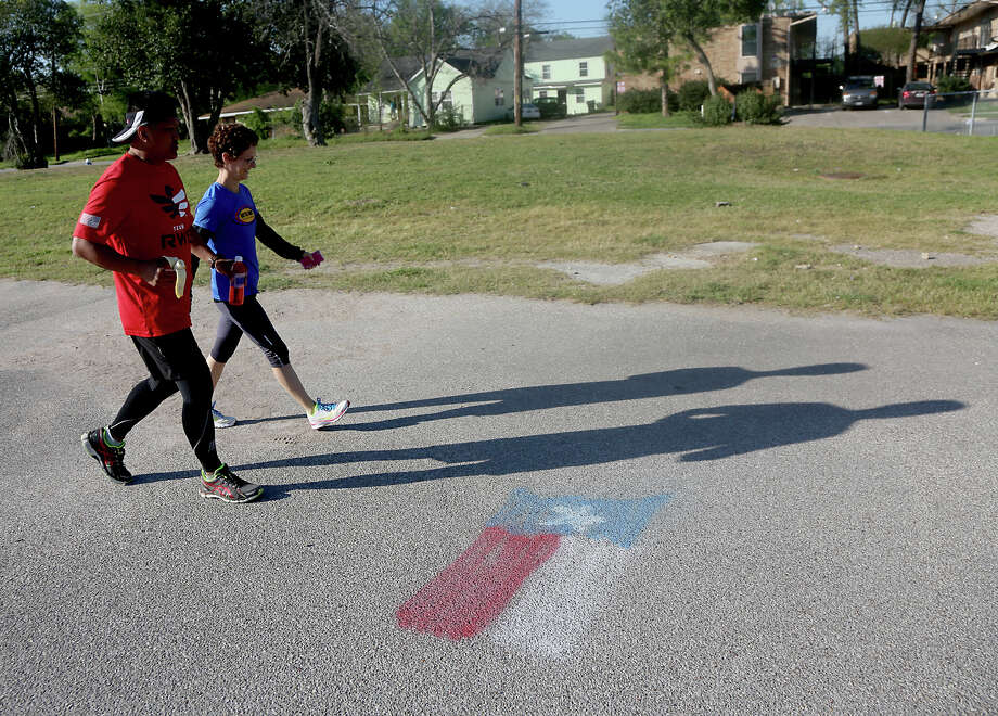 3/24/13: Alain Ducante  and Patti Glinskiran run through parts of Houston. Alain Ducante ran the entire 200 miles of the Texas Independence Relays starting in Gonzales, Texas  at 3 am and finished at the San Jacinto Monument. Photo: Thomas B. Shea, For The Chronicle / © 2013 Thomas B. Shea