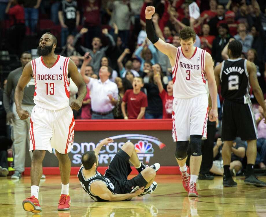 Houston Rockets shooting guard James Harden (13) and center Omer Asik (3) celebrate after defeating Manu Ginobili (20), Kawhi Leonard (2) and the rest of the Spurs at Toyota Center on Sunday, March 24, 2013, in Houston. Harden hit a jumper with 4.5 seconds left to play for the game-winner as the Rockets won the game 96-95. Photo: Smiley N. Pool, Houston Chronicle / © 2013  Houston Chronicle