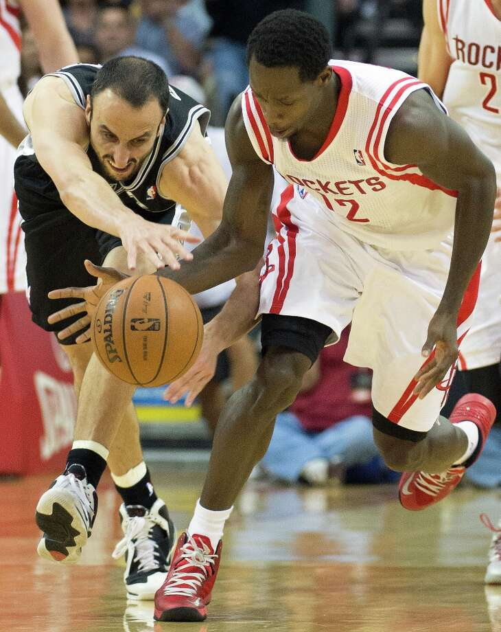Houston Rockets point guard Patrick Beverley (12) steals the ball from Spurs shooting guard Manu Ginobili (20) during the second half at Toyota Center on Sunday, March 24, 2013, in Houston. The Rockets won the game 96-95. Photo: Smiley N. Pool, Houston Chronicle / © 2013  Houston Chronicle