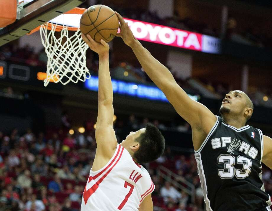 Spurs center Boris Diaw (33) blocks a shot by Houston Rockets point guard Jeremy Lin (7) during the second half at Toyota Center on Sunday, March 24, 2013, in Houston. The Rockets won the game 96-95. Photo: Smiley N. Pool, Houston Chronicle / © 2013  Houston Chronicle