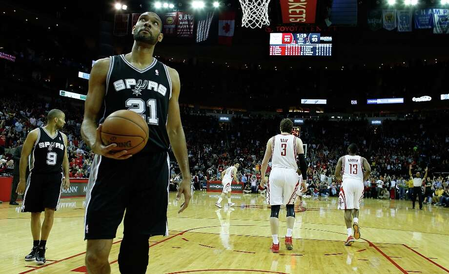 Tim Duncan (21) and Tony Parker (9) of the Spurs wait for a new play during the game against the Houston Rockets at Toyota Center on March 24, 2013 in Houston. Photo: Scott Halleran, Getty Images / 2013 Getty Images