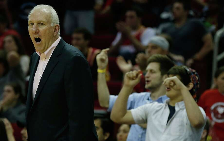 Spurs coach Gregg Popovich reacts to a play during the game against the Houston Rockets at Toyota Center on March 24, 2013 in Houston. Photo: Scott Halleran, Getty Images / 2013 Getty Images