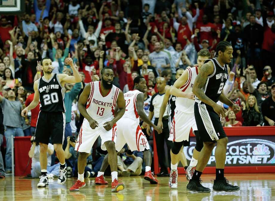 James Harden (13) of the Houston Rockets (center) celebrates his game-winning shot to defeat the Spurs 96-95 at Toyota Center on March 24, 2013 in Houston. Photo: Scott Halleran, Getty Images / 2013 Getty Images