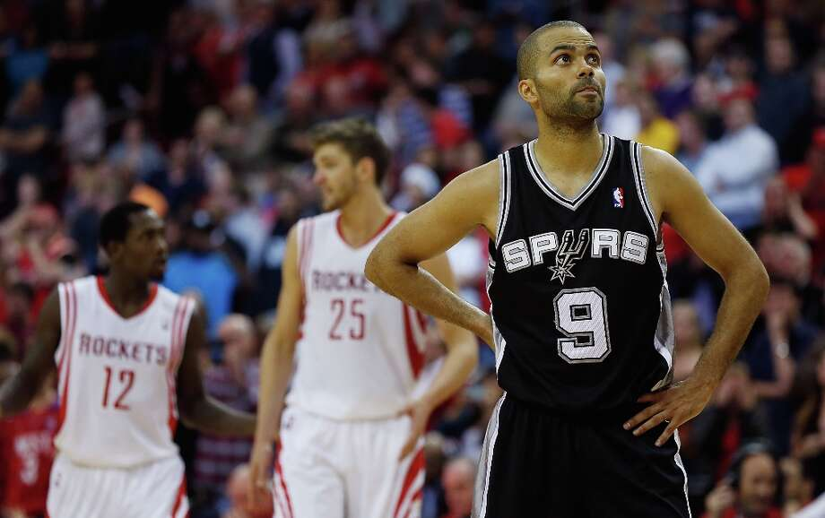 Tony Parker (9) of the Spurs waits on the court during the game against the Houston Rockets at Toyota Center on March 24, 2013 in Houston. Photo: Scott Halleran, Getty Images / 2013 Getty Images