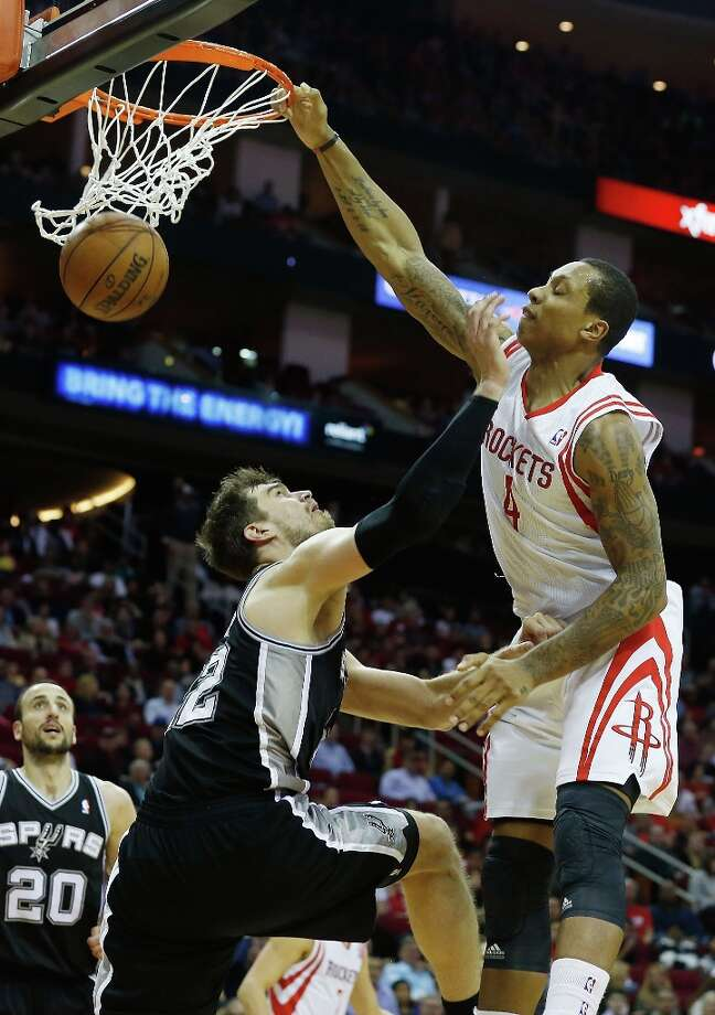 Greg Smith (4) of the Houston Rockets dunks over Tiago Splitter (22) of the Spurs at Toyota Center on March 24, 2013 in Houston. Photo: Scott Halleran, Getty Images / 2013 Getty Images