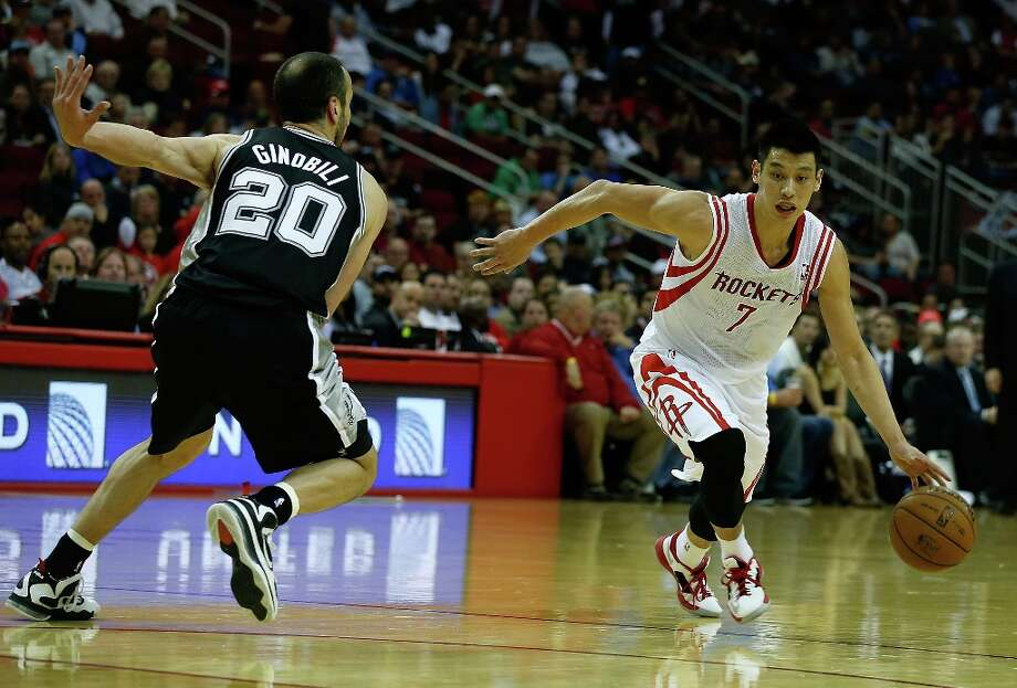 Jeremy Lin (7) of the Houston Rockets dribbles the ball in front of Manu Ginobili (20) of the Spurs at Toyota Center on March 24, 2013 in Houston. Photo: Scott Halleran, Getty Images / 2013 Getty Images