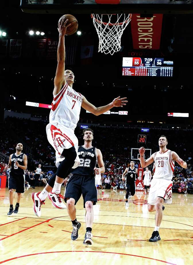 Jeremy Lin (7) of the Houston Rockets shoots over Tiago Splitter (22) of the Spurs at Toyota Center on March 24, 2013 in Houston. Photo: Scott Halleran, Getty Images / 2013 Getty Images