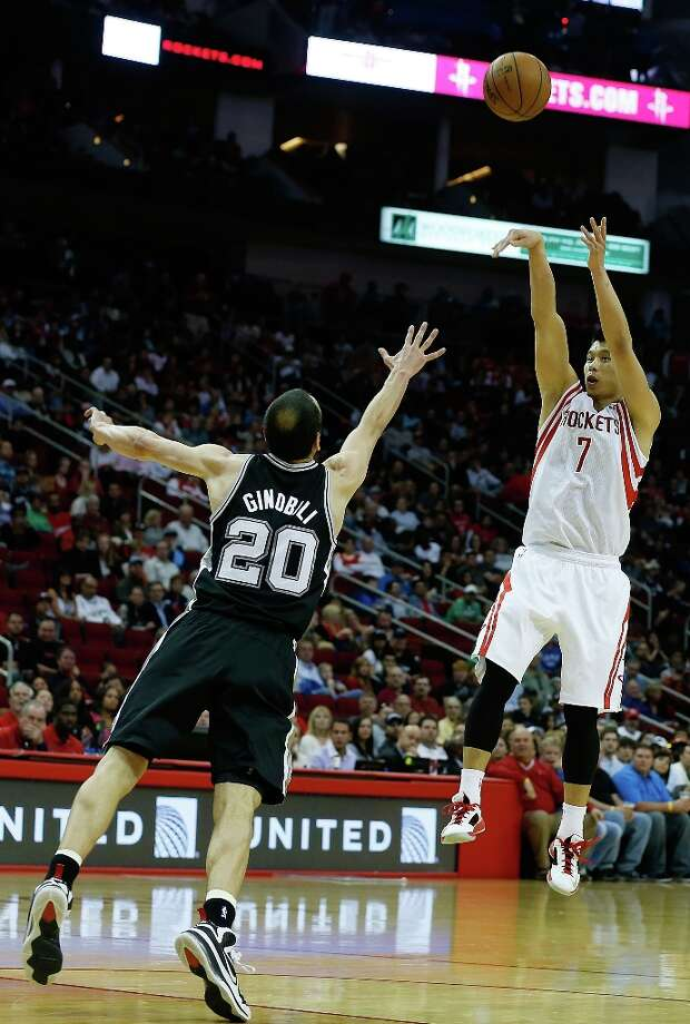 Jeremy Lin (7) of the Houston Rockets shoots over Manu Ginobili (20) of the San Antonio Spurs at Toyota Center on March 24, 2013 in Houston. Photo: Scott Halleran, Getty Images / 2013 Getty Images