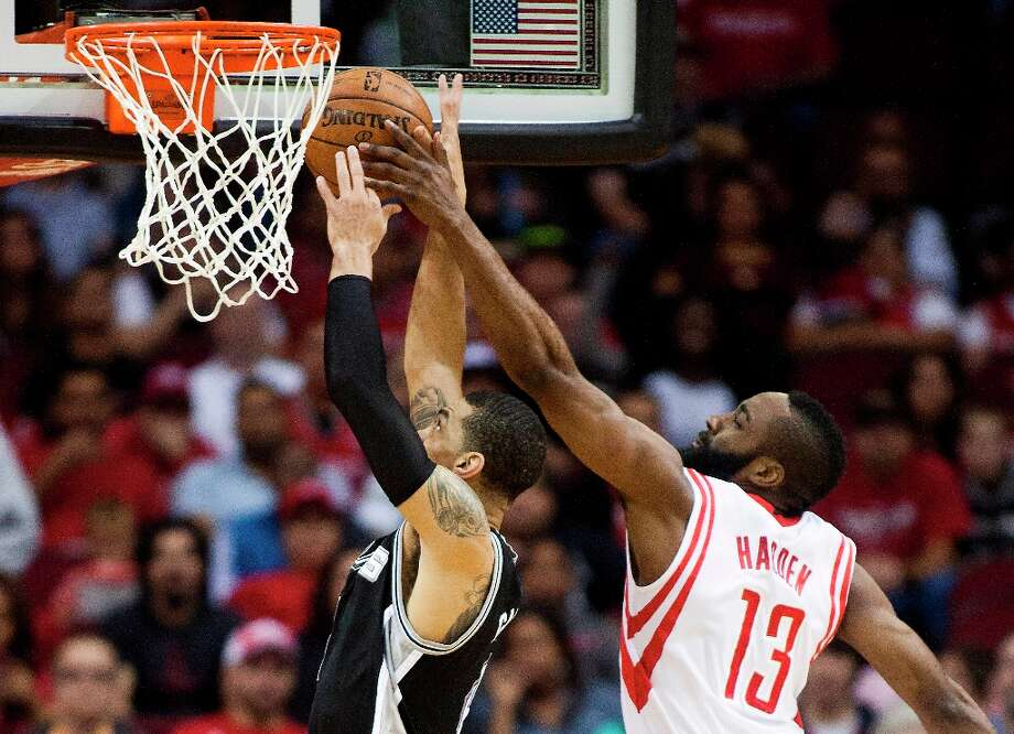 Houston Rockets guard James Harden (13) blocks Spurs guard Danny Green during the first half Sunday March, 24, 2013 at Toyota Center Houston. Photo: Patric Schneider, Associated Press / FR170473 AP