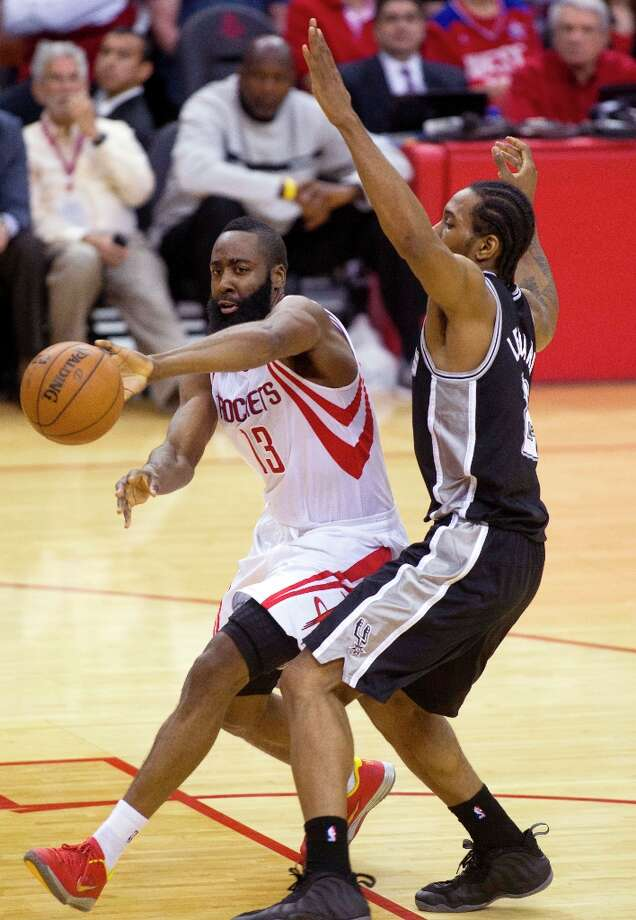 Houston Rockets guard James Harden (13) dribbles around the Spurs' Kawhi Leonard (2) during the second half Sunday, March, 24, 2013 in Houston. Photo: Patric Schneider, Associated Press / FR170473 AP