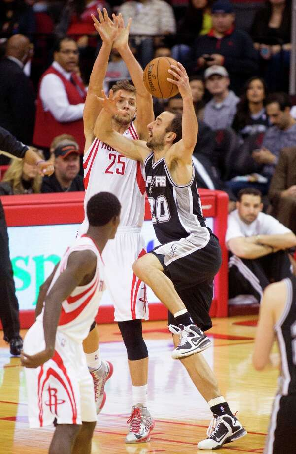 Spurs guard Manu Ginobili (20) takes a shot over Houston Rockets forward Chandler Parsons (25) during the first half Sunday, March, 24, 2013 in Houston. Photo: Patric Schneider, Associated Press / FR170473 AP