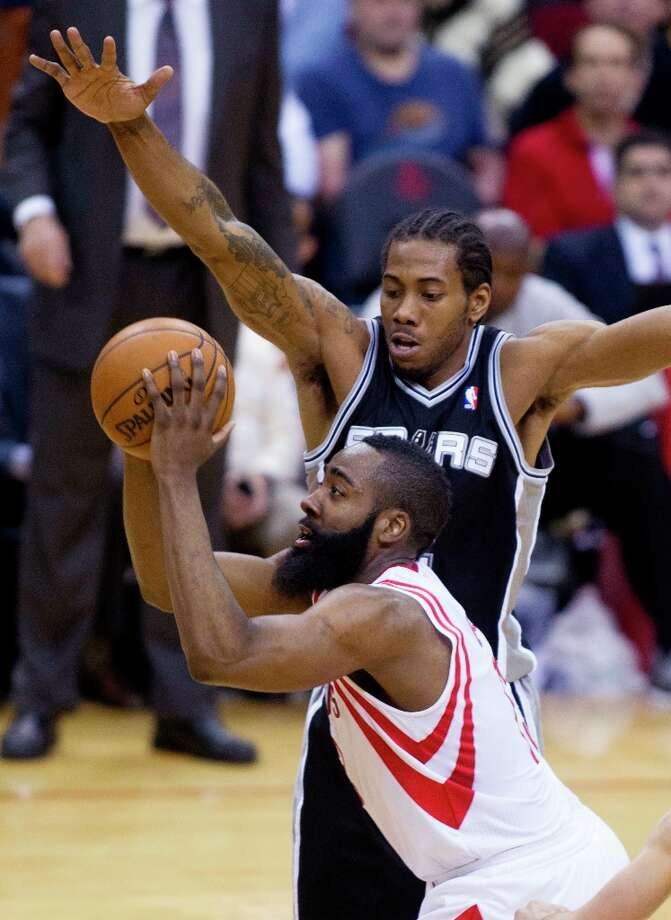 Houston Rockets guard James Harden (13) shoots over the Spurs' Kawhi Leonard (2) during the second half Sunday, March, 24, 2013 in Houston. Photo: Patric Schneider, Associated Press / FR170473 AP