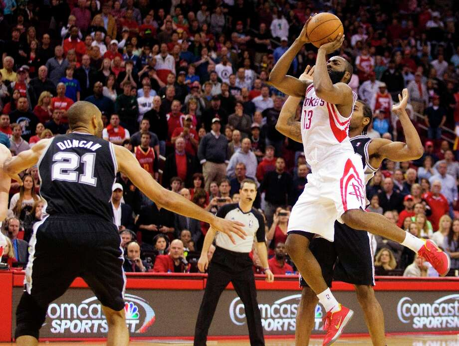 Houston Rockets guard James Harden shoots with 4.5 seconds left in an NBA basketball game against the Spurs on Sunday, March, 24, 2013, in Houston. The Rockets won 96-95. Photo: Patric Schneider, Associated Press / FR170473 AP